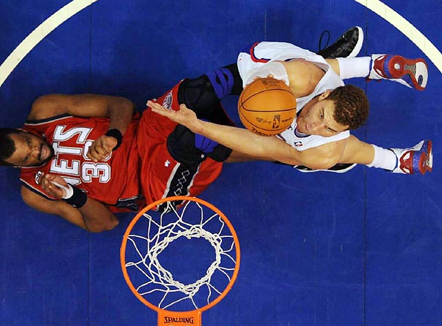 Clippers big man Blake Griffin dunks over floored New Jersey center Shelden Williams.