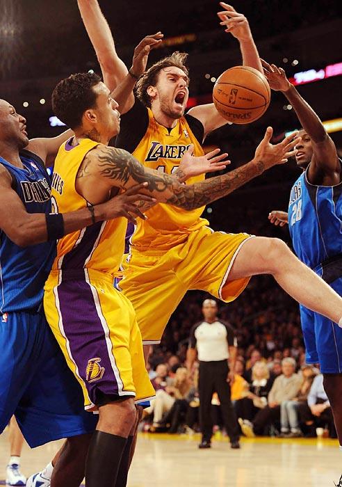 Lakers center Pau Gasol flails in the lane against the Dallas Mavericks.