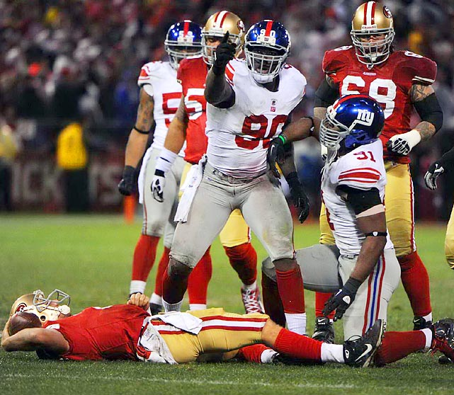 New York defensive end Jason Pierre-Paul celebrates after combining with Justin Tuck (91) for a sack of San Francisco quarterback Alex Smith during the Giants' 20-17 NFC Championship win.