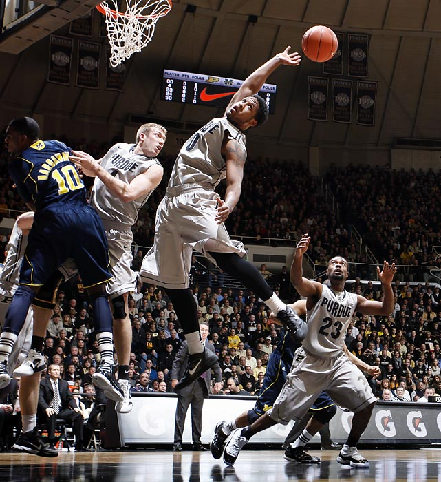 Purdue's Terone Johnson tries to corral a rebound in a game against Michigan.