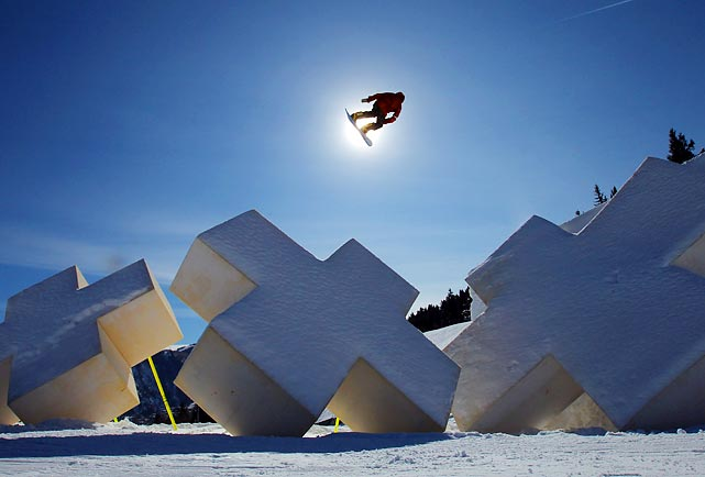 Canadian snowboarder Mark McMorris soars while practicing at the Winter X-Games.