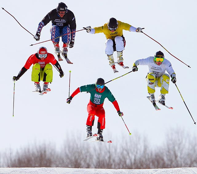 Christian Mithassel (yellow) leads the pack to win a semifinal heat in Skier X at the Winter X-Games.