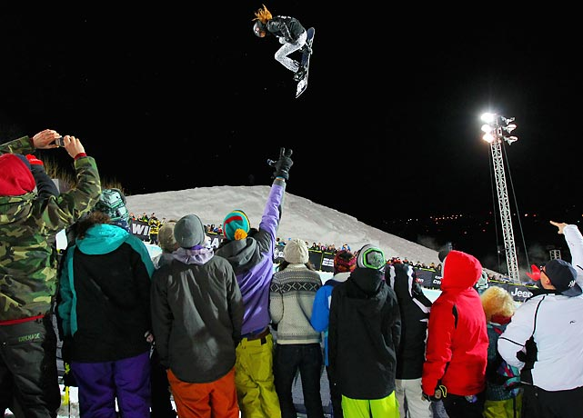 Shaun White soars above the crowd en route to winning his fifth-straight Winter X-Games gold medal in the Snowboard Superpipe. White scored a perfect 100 on his final run.