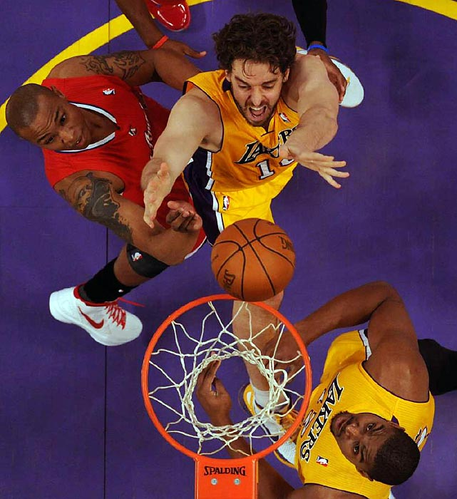 Lakers center Pau Gasol battles for a rebound with Clippers forward Caron Butler. The Lakers beat the Clippers 96-91 to improve to 1-1 against their intra-city rivals.
