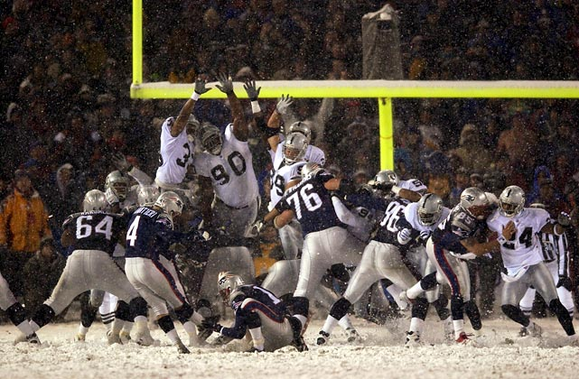 Vinatieri kicks the winning 23-yard field goal. The Patriots got the ball first in overtime and went 61 yards in 15 plays -- with Brady completing all eight of his passes -- to set up the kick.