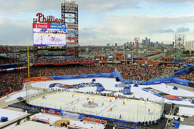 Playing on a rink that stretched from first base to third base, the Rangers made the league's fifth Winter Classic a memorable one, rallying from a 2-0 deficit to stay atop the Eastern Conference standings. The NHL surrounded the rink with Christmas trees, firewood, fake snow, and even trash-can fires a la the movie  Rocky , but there was nothing artificial about the elements with snow flurries late in the second period and temperatures that dipped into the 30s, forcing 49,967 fans to bundle up for the big game.
