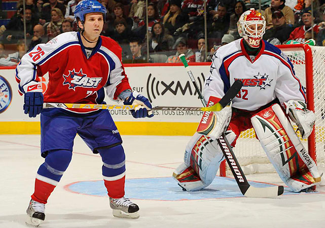 Martin St. Louis and Niklas Backstrom.