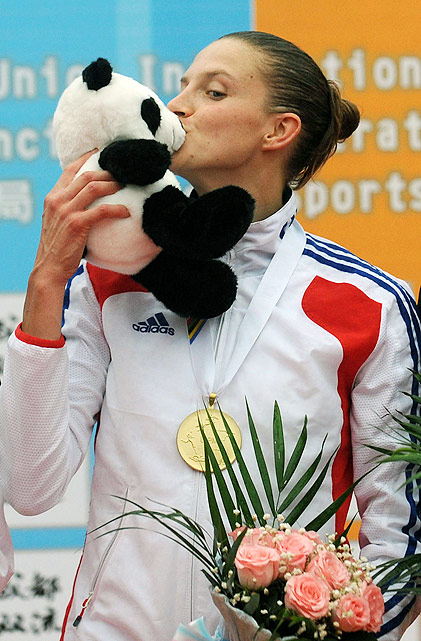 French pentathlete Amelie Caze celebrates her gold medal at the modern pentathlon world championships with a panda smooch.