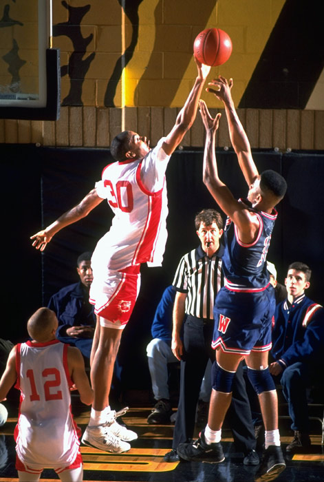 He was also named  USA Today 's High School Player of the Year in 1992-93.