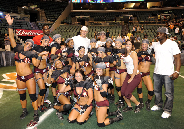 Of course, Gronkowski was still a 21-year-old rookie and wasn't shy about having fun. Here the tight end (white shirt, back center) poses with the Tampa Breeze before a Jan. 2010 Lingerie Football League game against the Miami Caliente.