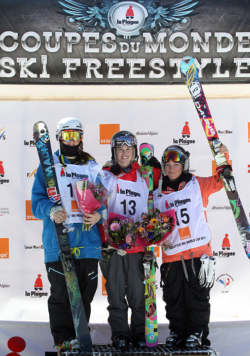 "A victorious Burke (center) stands on the podium with skiers Anais Caradeux and Davin Logan after the women's Ski Superpipe final in the European Winter X Games. According to a statement released by her publicist, Nicole Wool, tests revealed that Burke sustained ""irreversible damage to her brain due to lack of oxygen and blood after cardiac arrest."""