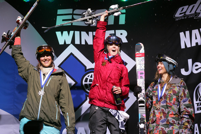 Burke (center) reacts with Jen Hudak and Jess Cumming at the Ski Superpipe final Winter X Games 13 in Aspen, Colo. Burke won the event.