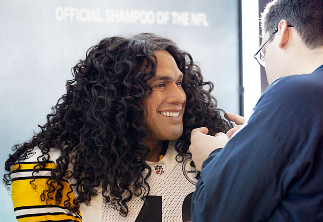 That's not Troy Polamalu. A man adjusts the hair on a life-like model of the Steelers safety at the Head & Shoulders booth.