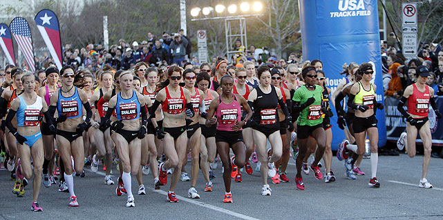 Competitors on the women's side start the 26.22-mile journey.