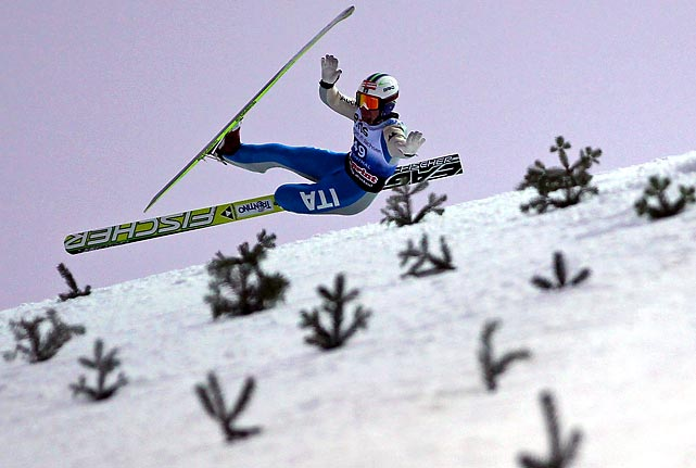 Italian skier Alessandro Pittin falls during a training run for the Nordic Combined World Cup event in Klingenthal, Germany.