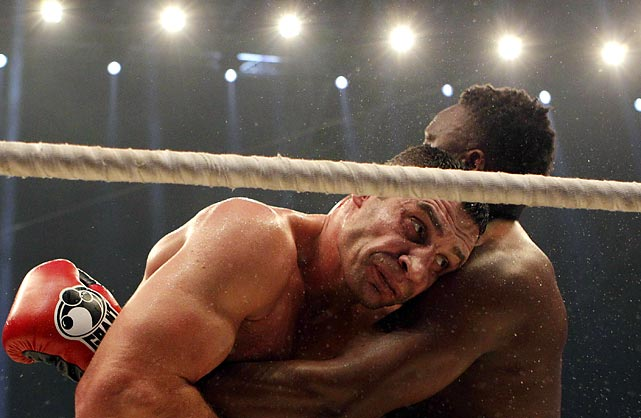 WBC Heavyweight Champ Vitali Klitschko (left) fights with British challenger Dereck Chisora during their title bout in Munich. Klitschko won the fight.