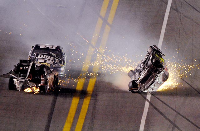 Jeff Gordon (right) flips his No. 24 car after colliding with Kurt Busch as Jimmie Johnson drives behind Busch during the NASCAR Budweiser Shootout at Daytona.