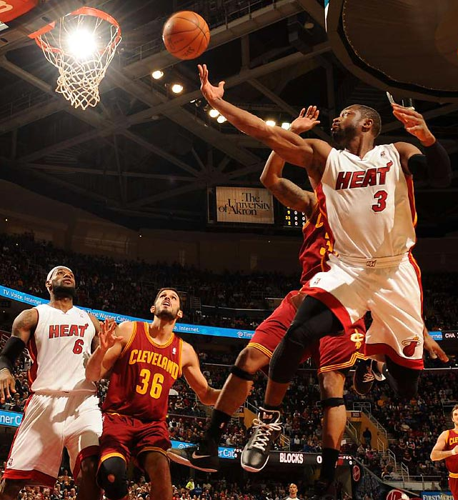 Heat star Dwyane Wade attempts a finger roll against the Cavs.