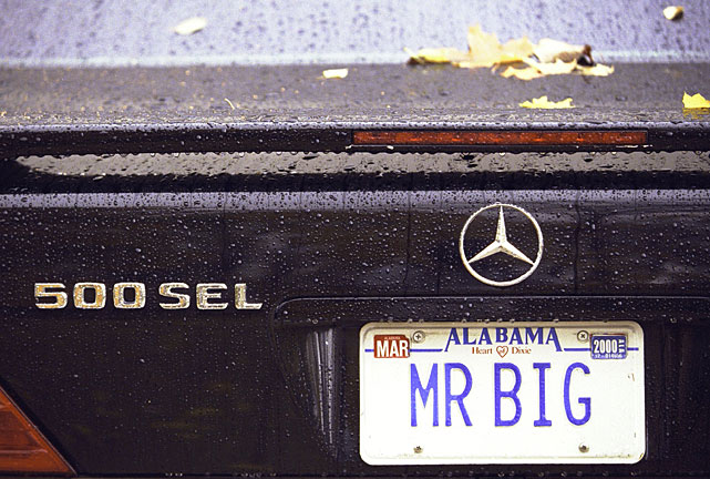 """Former Bengals defensive end John Copeland shows off his """"MR. BIG"""" plates."""