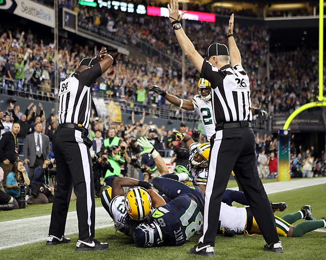 The NFL's use of replacement refs can to a screeching stop after a Week 3 game in which one official ruled an interception and the other ruled a touchdown (which stood) on the final play of a Seahawks-Packers game. The uproar over the blown call helped push the NFL toward settling its labor dispute with the regular officials, who were back on the field for Week 4 of the season.