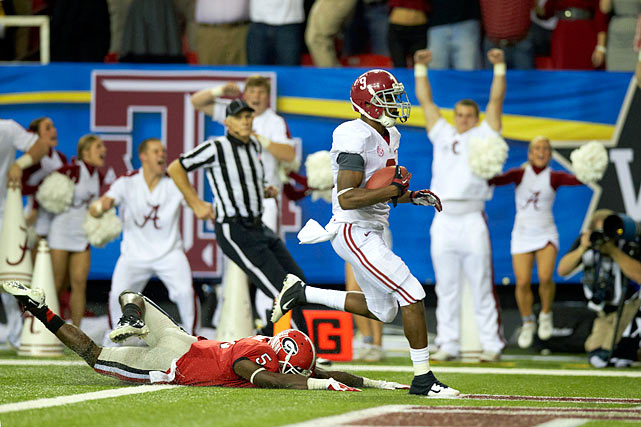 With a national title berth awaiting the winner, Alabama and Georgia played an uncharacteristically high-scoring SEC Championship, which made it all the more memorable. Alabama wideout Amari Cooper made a highlight reel catch, and eventually the game-clinching 45-yard touchdown reception with 3:15 remaining. Georgia quarterback Aaron Murray charged the Bulldogs 77 yards down the field in just over a minute, but his decision to not spike the ball proved costly in the end as wide receiver Chris Conley ended up with the ball in bounds as time expired. Alabama's 32-28 win guaranteed it a spot to play Notre Dame in the BCS National Championship.