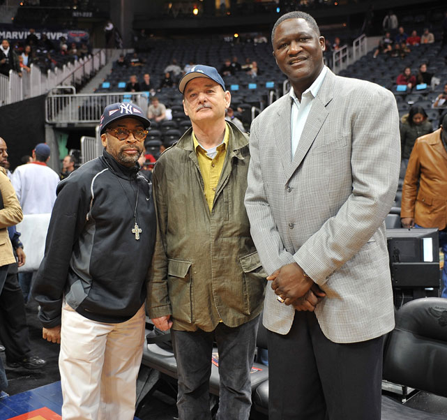 Murray looks thrilled while posing with director Spike Lee and former Hawks star Dominique Wilkins at a 2009 Atlanta-Cleveland game.