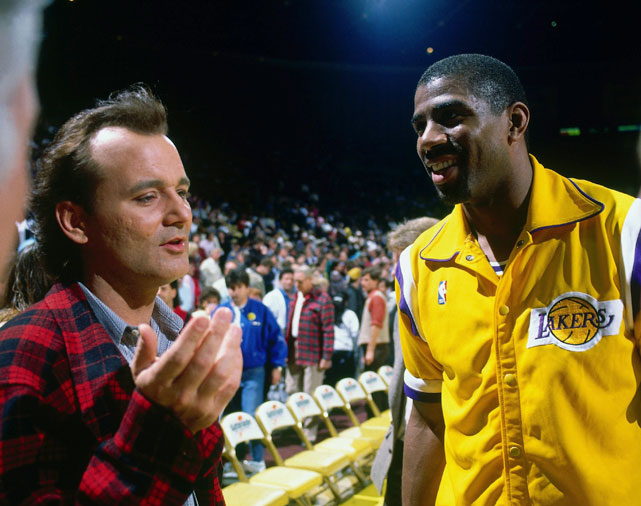Showtime: Murray poses with Magic Johnson before a 1988 Lakers game.