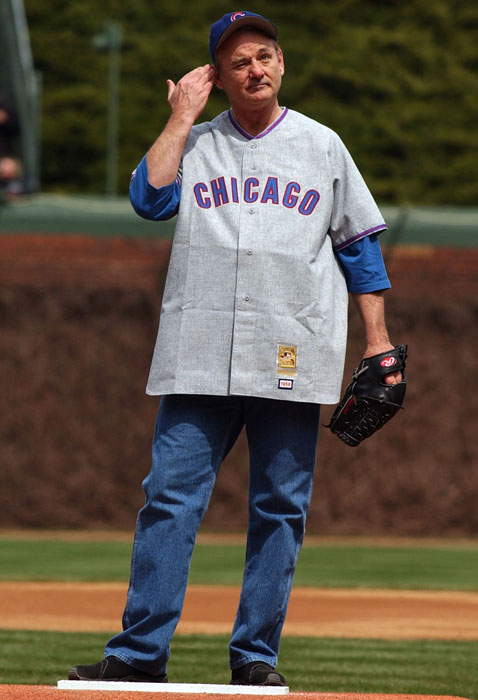 Murray plays to the crowd before throwing out the ceremonial first pitch at the 2004 Wrigley Field opener.