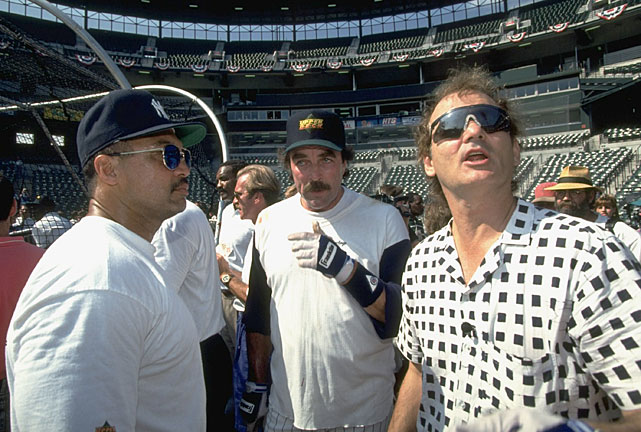 A clean-shaven Murray turns his face in shame while talking to the magnificently mustachioed Reggie Jackson and Tom Selleck at the 1993 MLB All-Star Old Timers' game.