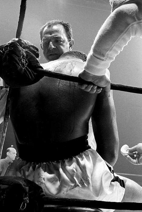Dundee stands over Ali between rounds of the 1963 fight against Doug Jones. One of the sport's all-time great motivators, Dundee helped Ali become the first three-time heavyweight champion.