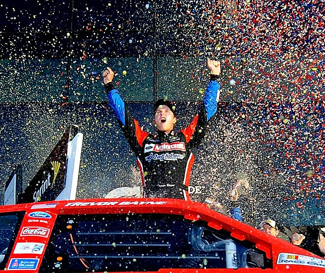 An elated Trevor Bayne celebrates in victory lane after winning the 2011 race. Bayne moved into the lead when David Ragan went to pit during a caution after lap 203 and held on to win his first race in the Sprint Cup Series at just 20 years old.