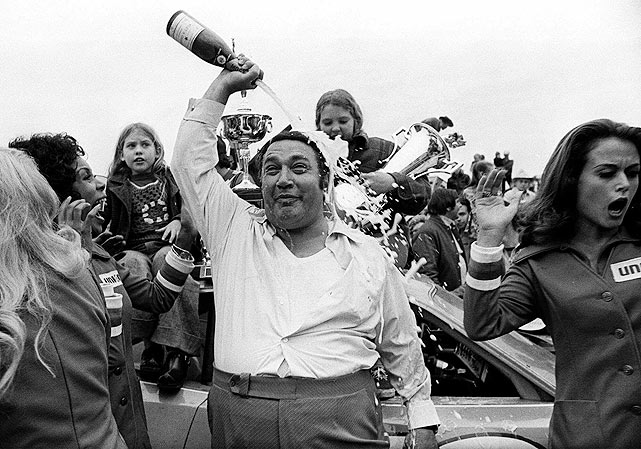STP CEO and car owner Andy Granatelli pours champagne on himself after Richard Petty drove the No. 43 car to victory at the 1973 Daytona 500.