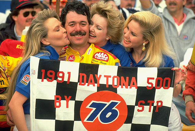 Ernie Irvan poses with a few models after winning the 1991 race.