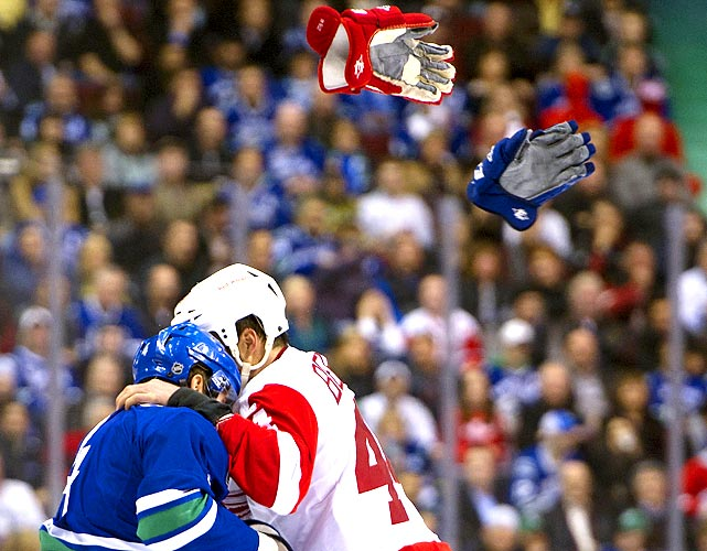 The gloves were off as the Canuck and Red Wing shared a warm embrace during their fight in the third period of their hockey game.