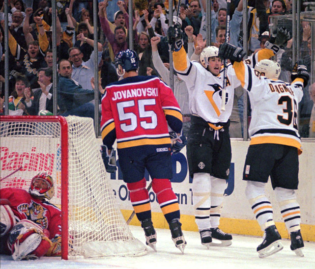 Jagr (68) and Pittsburgh teammate J.J. Daigneault (36) celebrate Daigneault's playoff goal against the Florida Panthers. Jagr had 439 goals and 640 assists in 11 seasons with the Penguins.