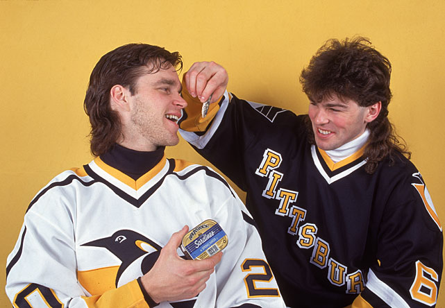 Jagr pretends to feed sardines to Penguins teammate Luc Robitaille in a 1995 photo shoot. Jagr was a finalist for the Hart Trophy (MVP) in 1995 and 1998 before winning the award in 1999. He was also a MVP finalist in 2000, 2001 and 2006.