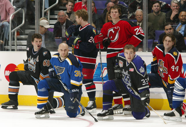 Jaromir Jagr (far left) on the ice with fellow World Stars (left to right) Pavol Demitra, Espen Knutsen, Patrik Elias, Ziggy Palffy and Sandis Ozolinsh at the 2002 All-Star SuperSkills competition.