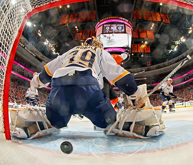 Nashville goalie Anders Lindback lets a shot through the five-hole against Philadelphia.