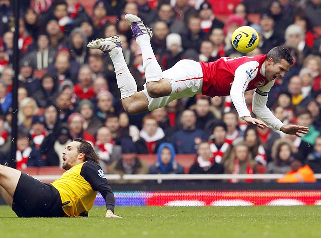 Blackburn's Gael Givet tackles Arsenal's Robin Van Persie during an English Premier League match. Givet was sent off for the challenge.