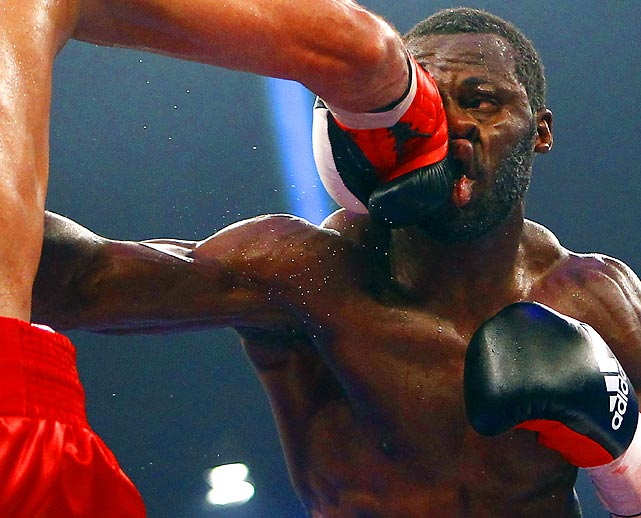 "Challenger Steve ""USS"" Cunningham takes a punch from Yoan Pablo Hernandez during their IBF cruiserweight title fight in Frankfurt, Germany."