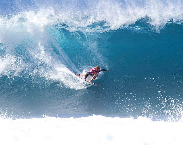 Surfer Jamie O'Brien rides a wave during the final round of the Volcom Pipe Pro on the north shore of Oahu, Hawaii.
