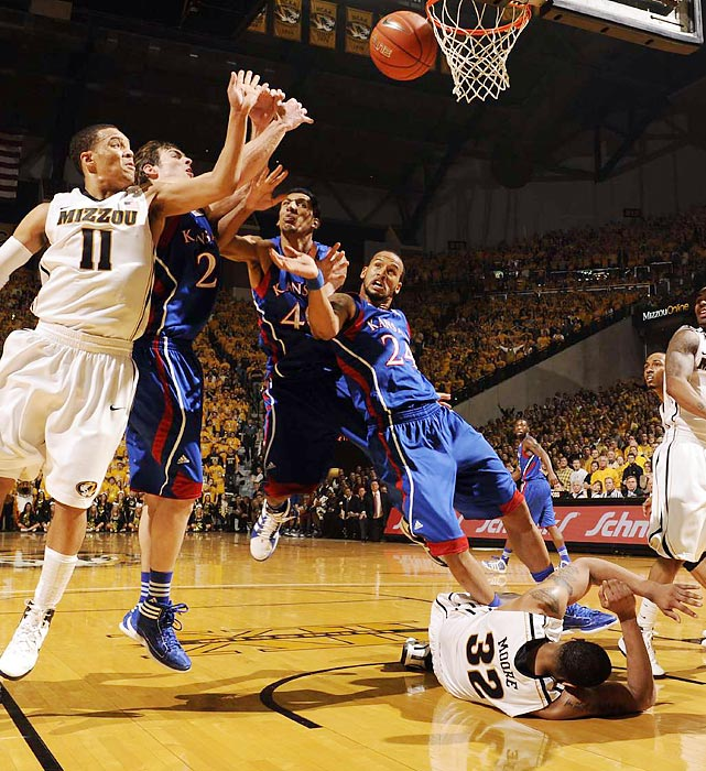 Several players fight for a loose ball in Saturday's Missouri-Kansas game. Mizzou won the battle of top-10 teams, squeaking by the Jayhawks at home.