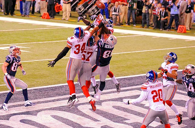 New England tight end Aaron Hernandez fights with several New York defenders for a Hail Mary in the dying seconds of the Super Bowl.