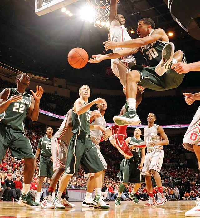 Michigan State guard Brandon Wood passes to Branden Dawson in the Spartans' upset win at Ohio State on Saturday.