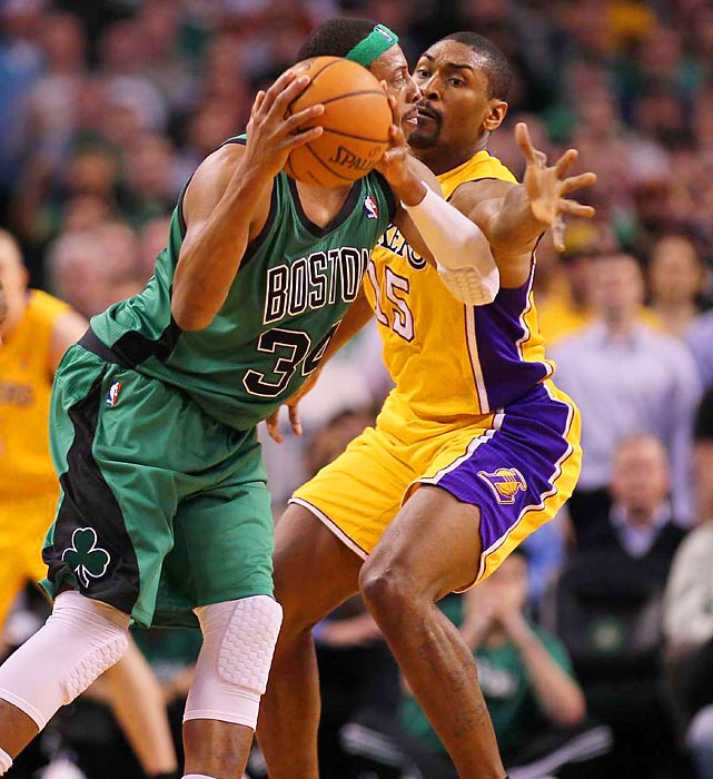 Celtics star Paul Pierce is guarded by Lakers forward Metta World Peace at the TD Garden.