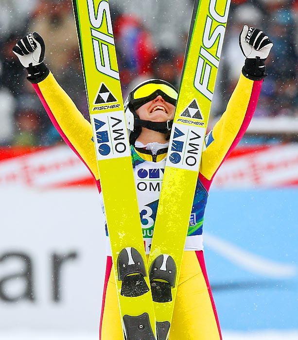 Austrian skier Jacqueline Seifriedsberger celebrates after taking third place in the Ski Jumping World Cup event in Slovenia.
