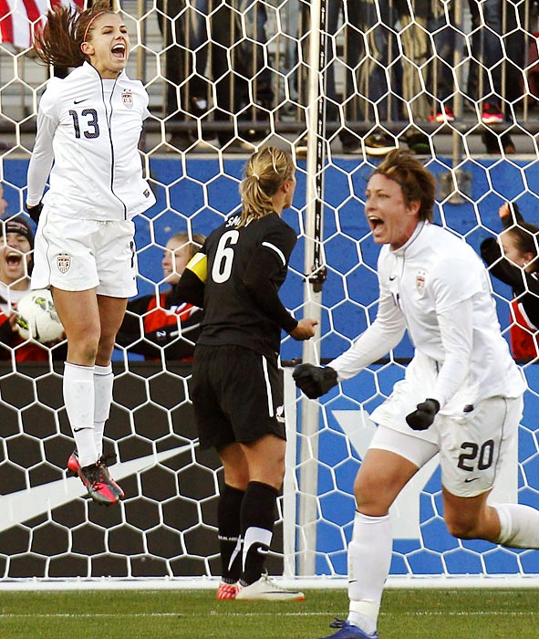U.S. national team forwards Alex Morgan (13) and Abby Wambach (20) celebrate Morgan's game-winning goal during the second half of an international friendly against New Zealand.