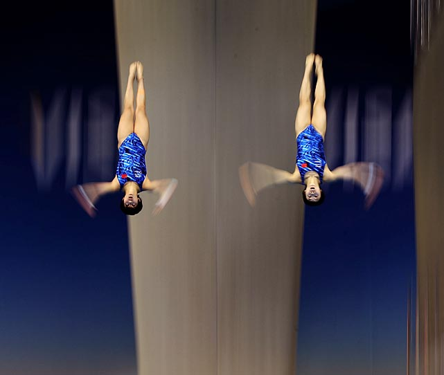 Chinese divers Ruolin Chen and Hao Wang in action during the women's synchronized 10-meter platform final at the London Aquatics Center.