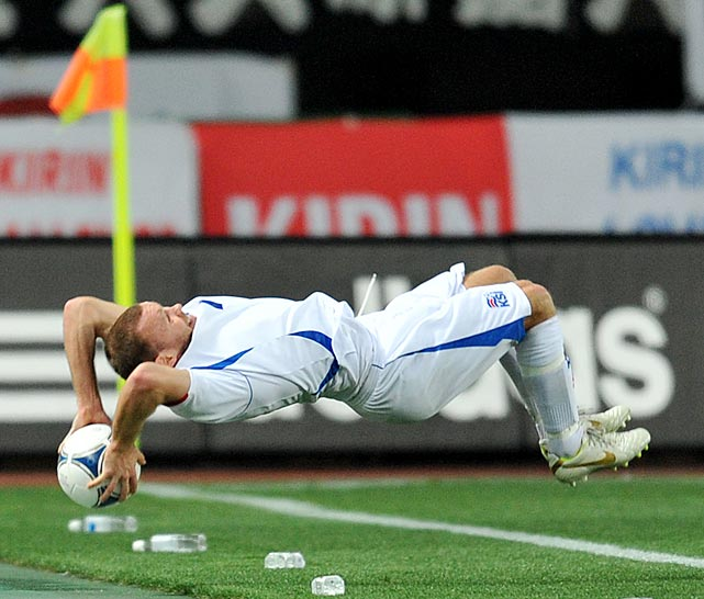Iceland's Steinthor Freyr Thorsteinsson finishes off a flip throw-in during a friendly soccer match against Japan.