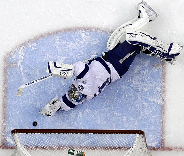 Tampa Bay goalie Dwayne Roloson can't quite reach a shot from Pittsburgh's Jordan Staal in the second period of the Penguins' 8-1 win on Saturday.